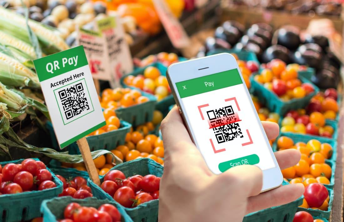 QR-Code-Zahlung auf einem Markt